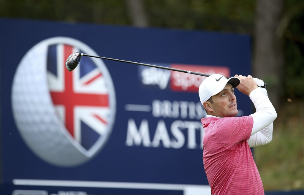 Italy's Francesco Molinari plays a shot on during day two of the British Masters at Walton Heath Golf Club, Surrey, Enland, Friday Oct. 12, 2018. (Ste