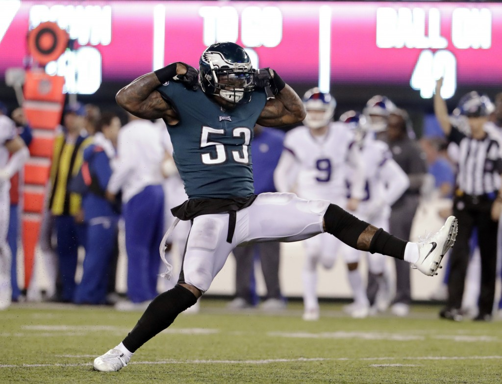 Philadelphia Eagles' Nigel Bradham (53) celebrates after sacking New York Giants quarterback Eli Manning during the second half of an NFL football gam
