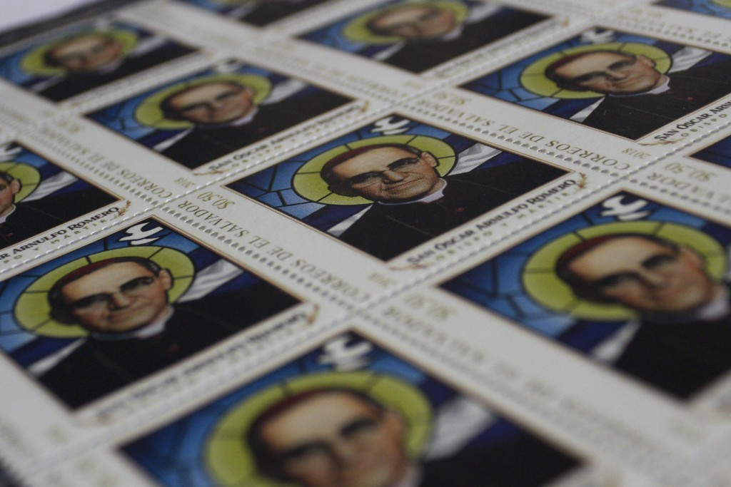 This Oct. 3. 2018 photo, shows a collection of official postage stamps with the image of Archbishop Oscar Arnulfo Romero, in San Salvador, El Salvador