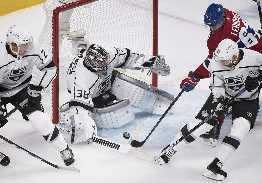 Los Angeles Kings goaltender Jack Campbell makes a save against Montreal Canadiens' Arturri Lehkonen (62) as Kings' Ilya Kovalchuk (17) and Paul LaDue