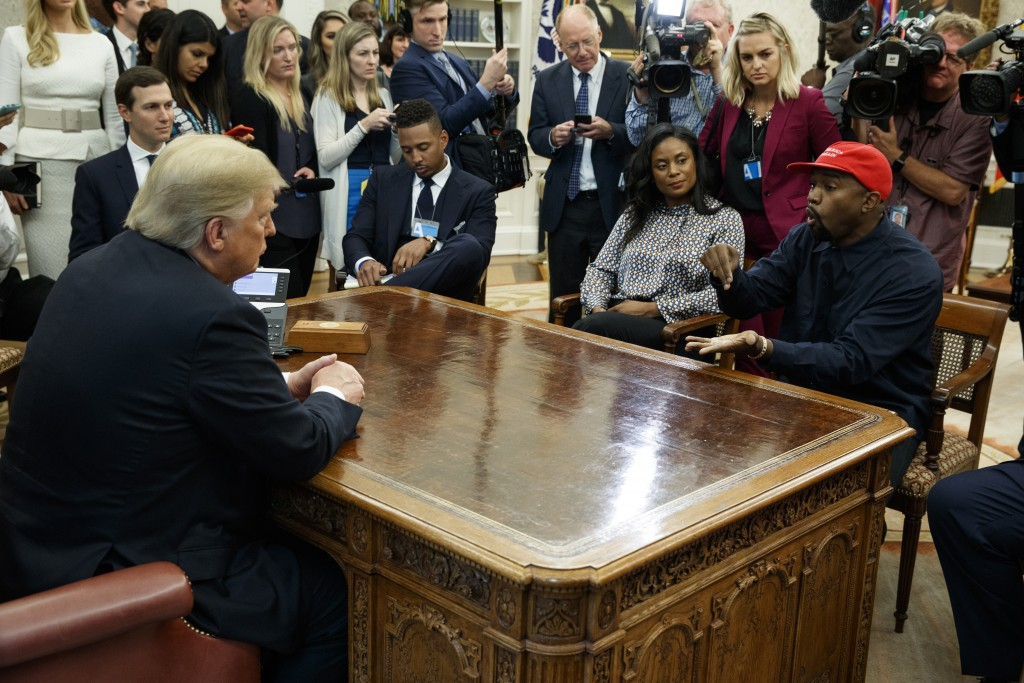 Rapper Kanye West speaks during a meeting with President Donald Trump in the Oval Office of the White House, Thursday, Oct. 11, 2018, in Washington. A