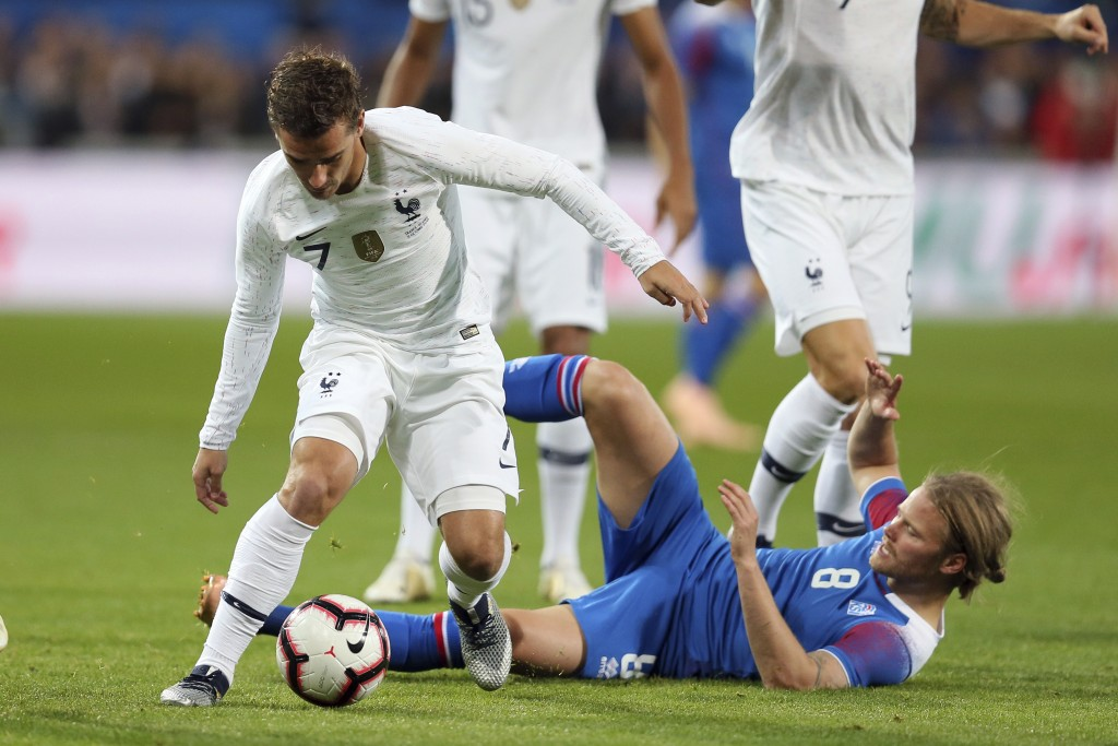France's Antoine Griezmann, left, and Iceland's Birkir Bjarnason challenge for the ball during a friendly soccer match between France and Iceland, in