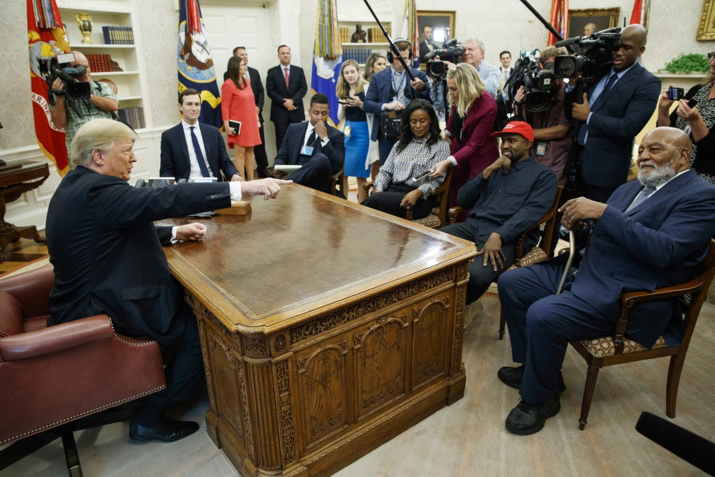 President Donald Trump meets with rapper Kanye West and former football player Jim Brown in the Oval Office of the White House, Thursday, Oct. 11, 201