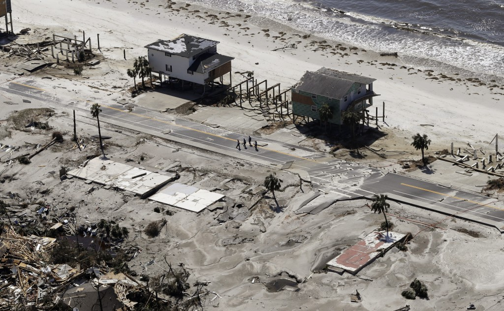 Homes are left swept off their foundations from the effects of Hurricane Michael, Thursday, Oct. 11, 2018, in Mexico Beach, Fla.    Michael made landf