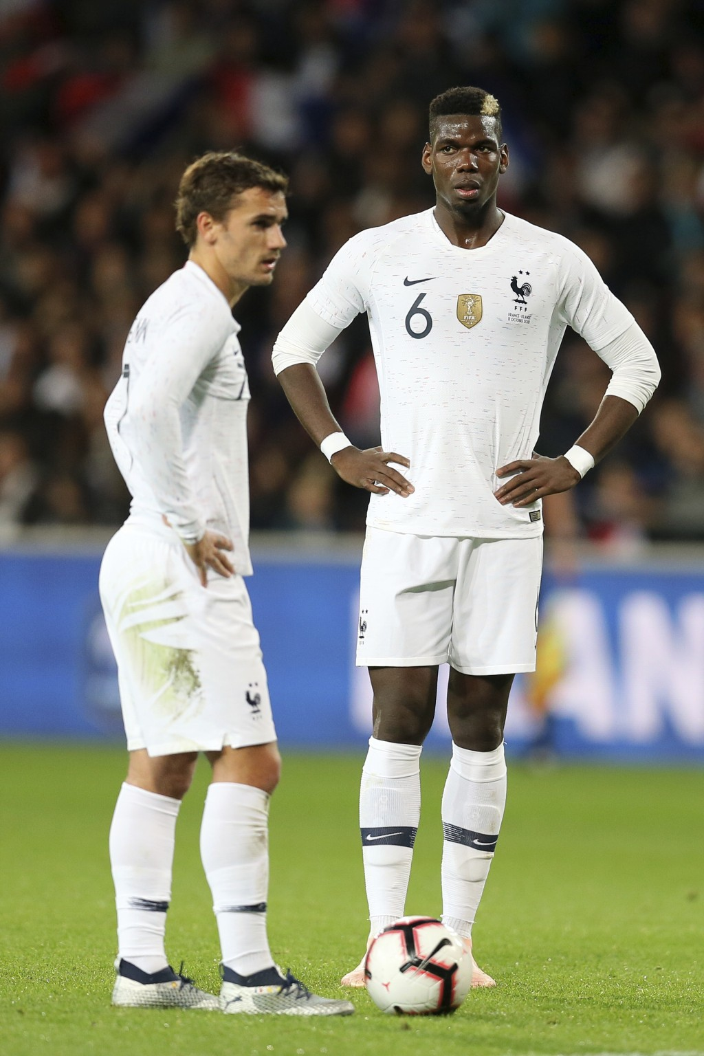 France's Antoine Griezmann, and Paul Pogba stand prior to shoot a free kick during a friendly soccer match between France and Iceland, in Guingamp, we