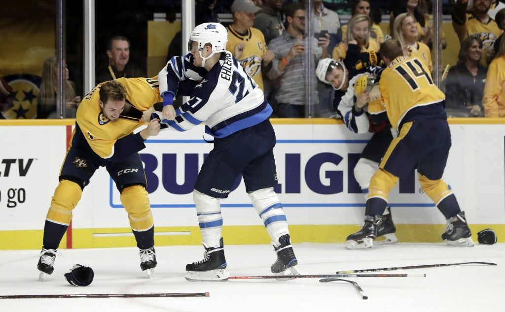 Nashville Predators center Colton Sissons (10) fights Winnipeg Jets left wing Nikolaj Ehlers (27), of Denmark, as Predators defenseman Mattias Ekholm
