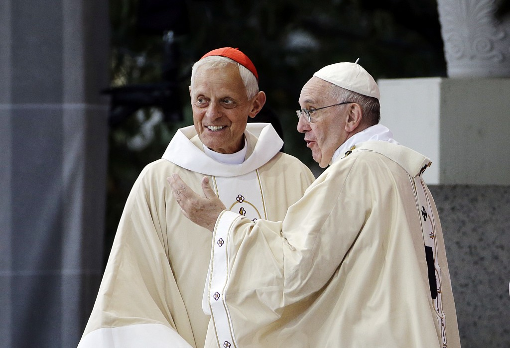 FILE - This Wednesday, Sept. 23, 2015 file photo shows Cardinal Donald Wuerl, archbishop of Washington, left, talking with Pope Francis after a Mass i