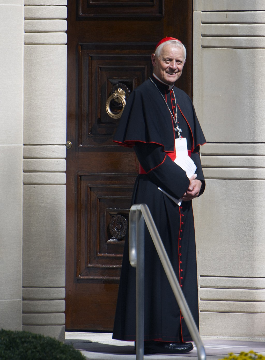FILE - In this Wednesday, Sept. 23, 2015 file photo Cardinal Donald Wuerl, archbishop of Washington, stands in the doorway of the Apostolic Nunciature
