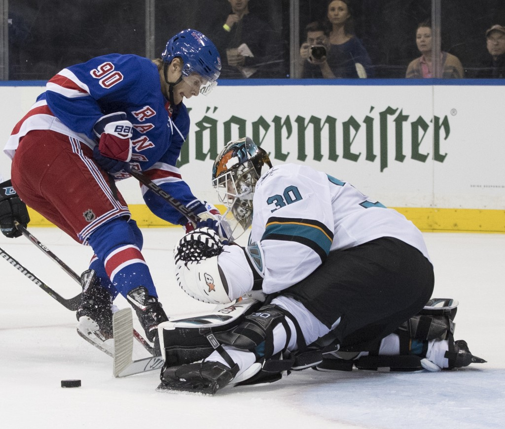 San Jose Sharks goaltender Aaron Dell makes a save against New York Rangers center Vladislav Namestnikov (90) during the second period of an NHL hocke