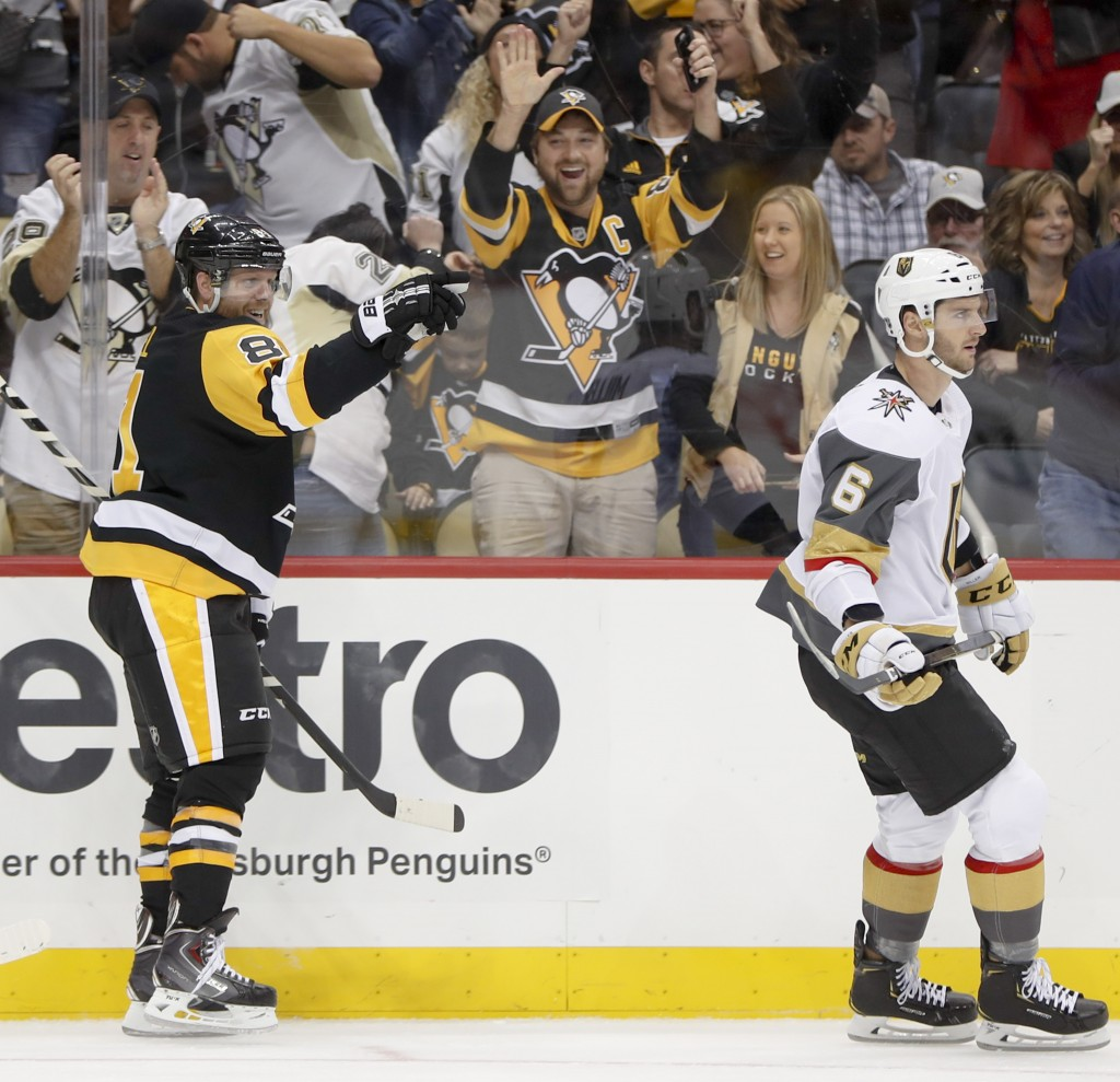 Pittsburgh Penguins' Phil Kessel, left, celebrates behind Vegas Golden Knights' Colin Miller after scoring his first goal during the second period, an