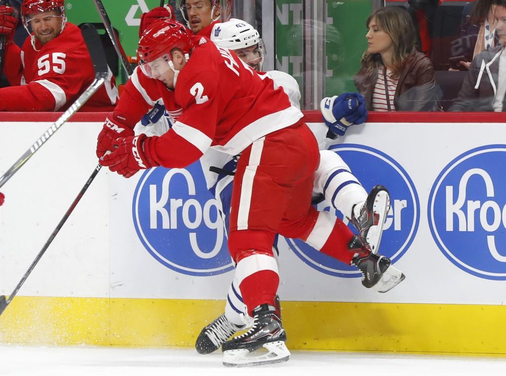 Detroit Red Wings defenseman Joe Hicketts (2) checks Toronto Maple Leafs center Nazem Kadri during the first period of an NHL hockey game Thursday, Oc
