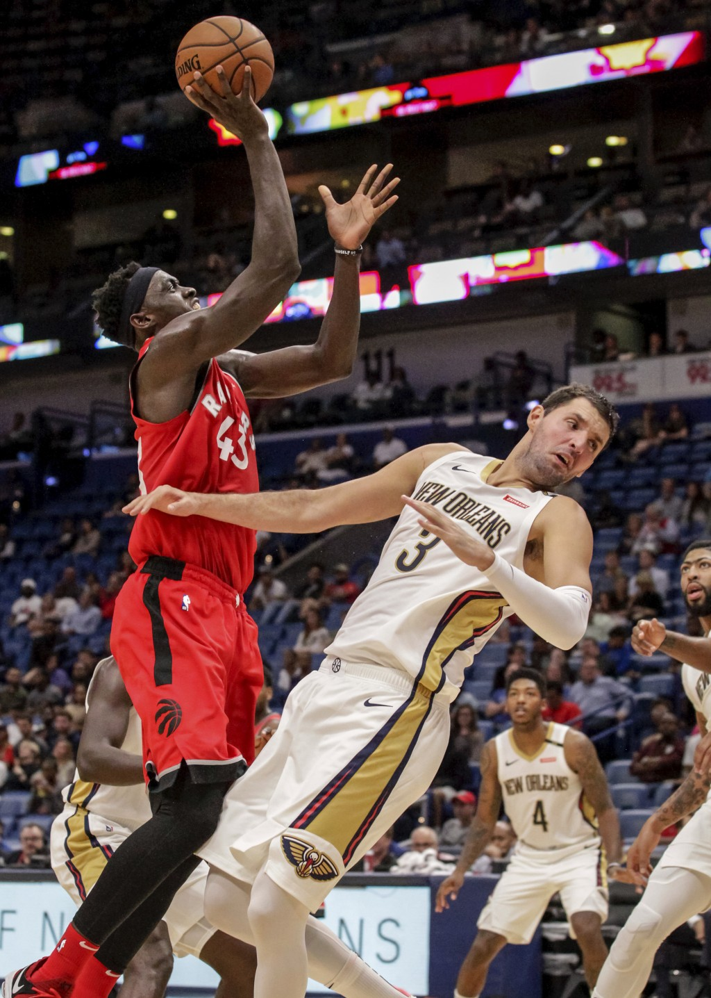 New Orleans Pelicans forward Nikola Mirotic (3) is called for blocking on a shot by Toronto Raptors forward Pascal Siakam (43) during the first half o