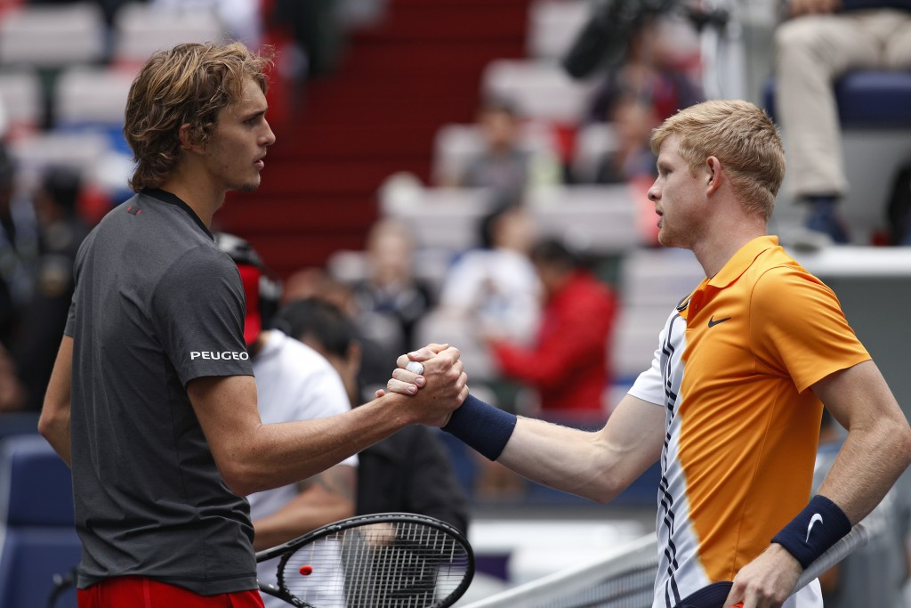 Alexander Zverev of Germany, left, shakes hands with Kyle Edmund of Britain after winning the men's singles quarterfinals match in the Shanghai Master