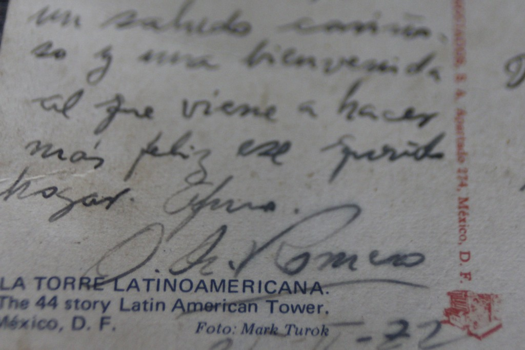 In this Oct. 4. 2018 photo, a 1972 postcard sent from Mexico City, shows the good wishes written by Archbishop Oscar Arnulfo Romero for the family of