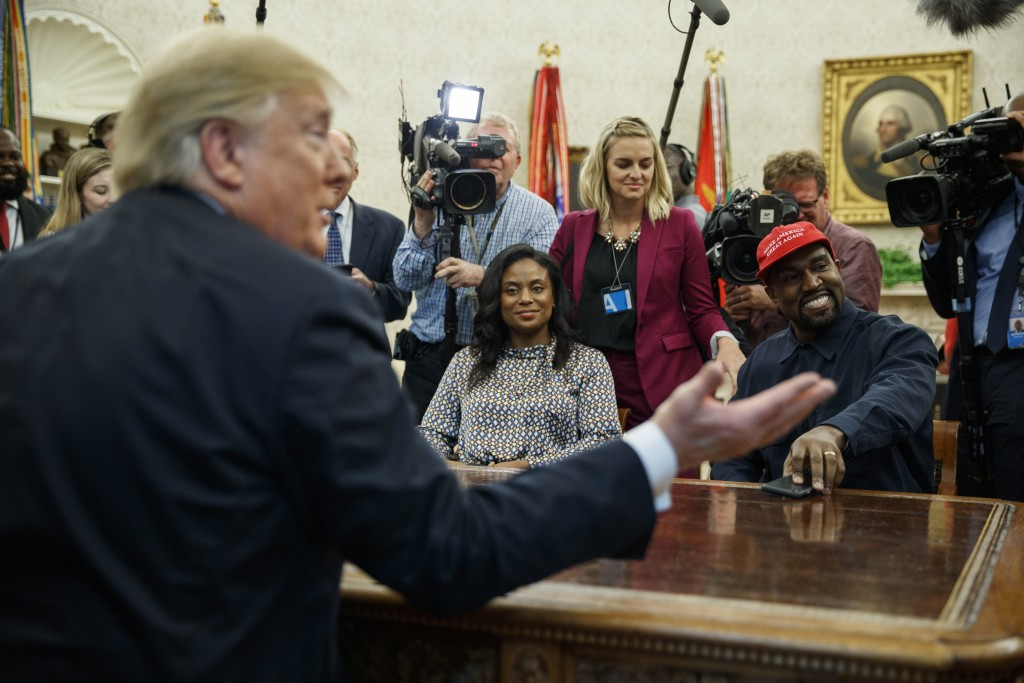 President Donald Trump meets with rapper Kanye West in the Oval Office of the White House, Thursday, Oct. 11, 2018, in Washington. (AP Photo/Evan Vucc