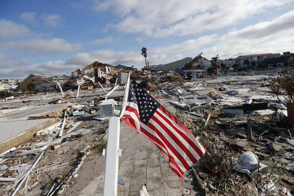 An American flag flies amidst destruction in the aftermath of Hurricane Michael in Mexico Beach, Fla., Thursday, Oct. 11, 2018. (AP Photo/Gerald Herbe