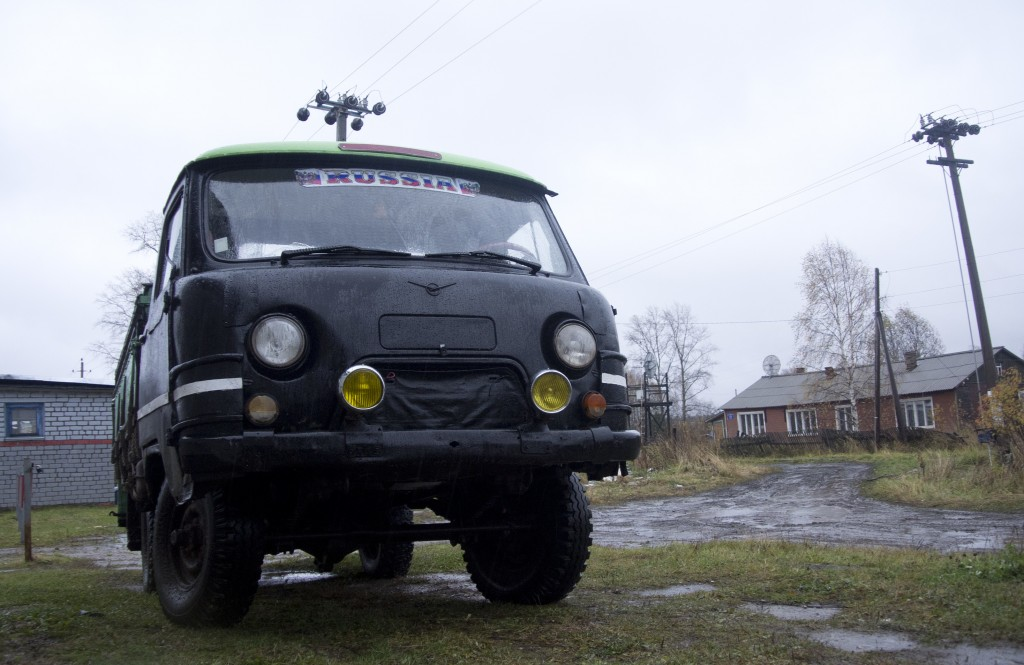"A van with the sticker ""Russia"" is parked on the street in Loyga in northern Russia, Wednesday Oct. 10, 2018. The career trajectories of suspected Rus"