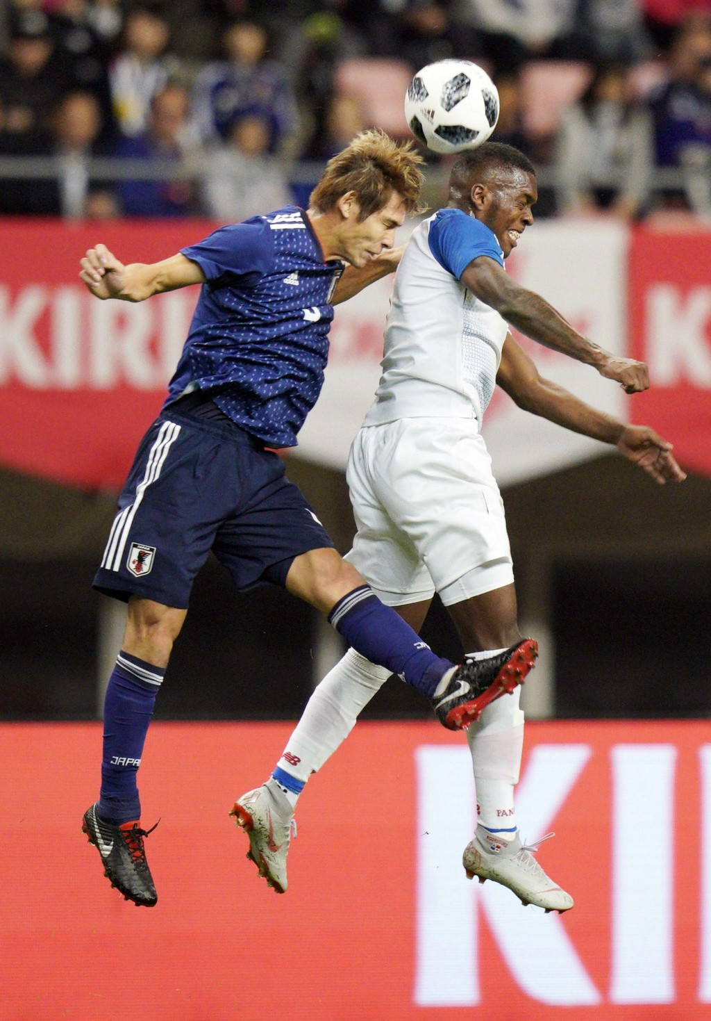Japan's Sho Sasaki, left, vies for the ball during their Kirin Challenge Cup soccer match against Panama in Niigata, Niigata prefecture, north of Toky