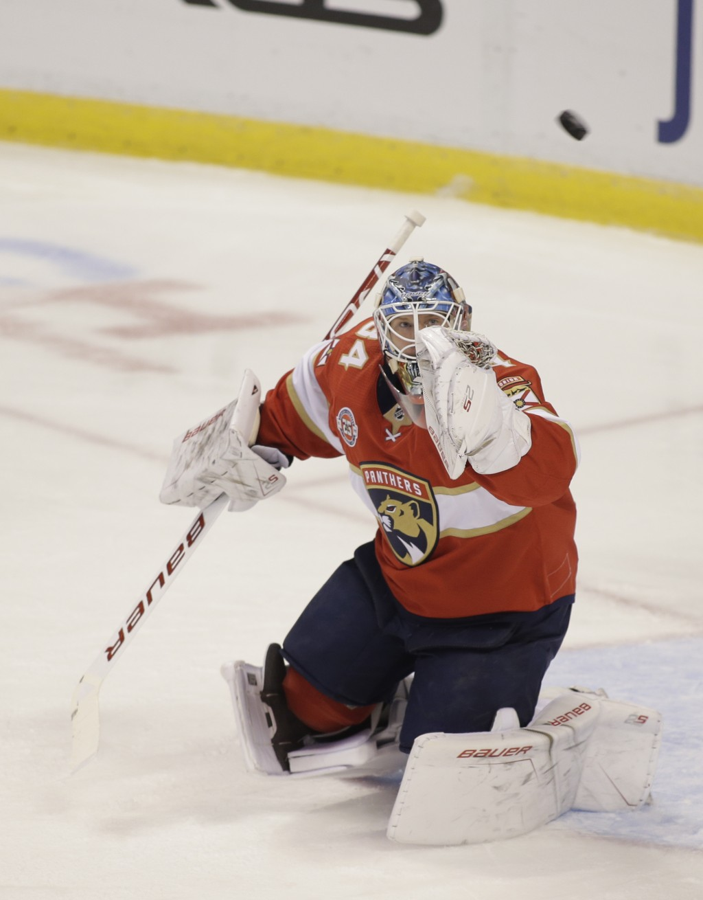 Florida Panthers goaltender James Reimer reaches for the puck during the first period of an NHL hockey game against the Columbus Blue Jackets on Thurs