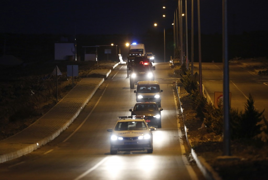 A convoy with U.S. pastor Andrew Brunson sitting inside a car arrives for his trial in Izmir, Turkey, early Friday, Oct. 12, 2018. The trial against a