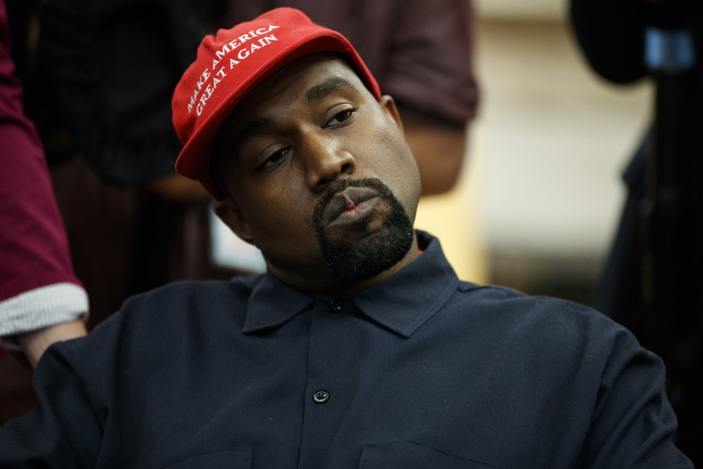 Rapper Kanye West listens to a question from a reporter during a meeting in the Oval Office of the White House with President Donald Trump, Thursday,