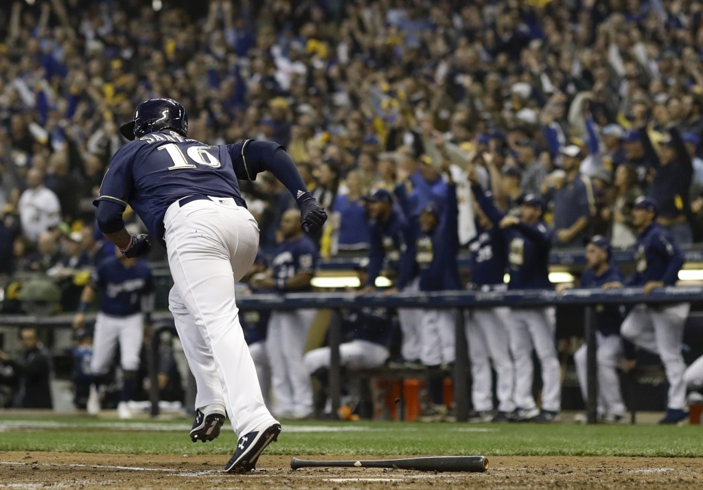 Milwaukee Brewers' Domingo Santana hits a two-run scoring double during the fourth inning of Game 1 of the National League Championship Series basebal