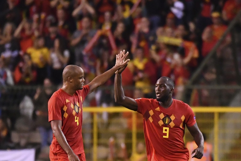 Belgium's Romelu Lukaku, right, celebrates with teammate Vincent Kompany after scoring his side's second goal during the UEFA Nations League soccer ma