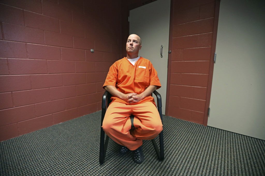 In this Tuesday, Oct. 9, 2018, photo, inmate Russell Henderson looks on during a prison interview at Wyoming Medium Correctional Institution, in Torri