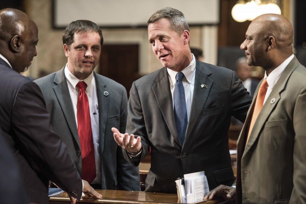 FILE - In this Jan. 24, 2018, file photo, Democratic gubernatorial nominee Rep. James Smith, D-Richland, second from right, talks with Lucas Atkinson,