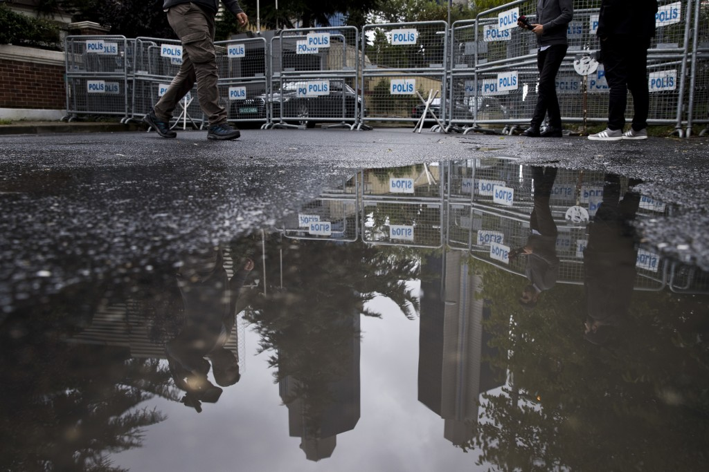 Journalist walk past metal barriers at the entrance of Saudi Arabia's consulate in Istanbul, Saturday, Oct. 13, 2018.  Turkish officials have an audio...