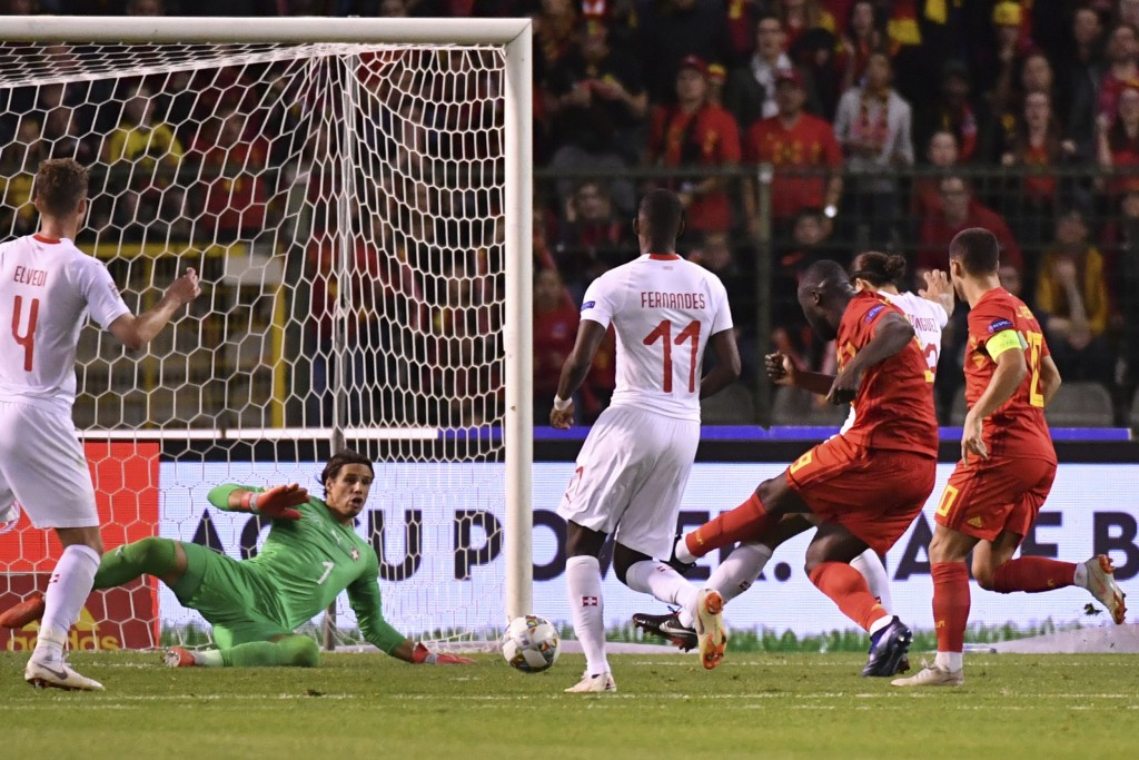 Belgium's Romelu Lukaku, second right, scores past Switzerland goalkeeper Yann Sommer, left, his side's second goal during the UEFA Nations League soc