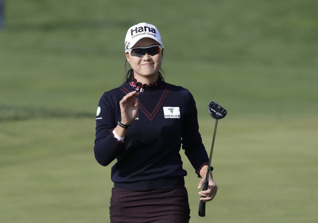 Minjee Lee of Australia reacts on the 18th hole after finishing the third round of the LPGA KEB Hana Bank Championship at Sky72 Golf Club in Incheon,