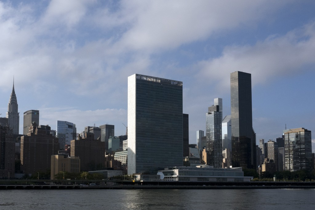 In this Oct. 10, 2018 photo, Trump World Tower, right, rises above the United Nations headquarters, center, in New York. Donald Trump's business ties