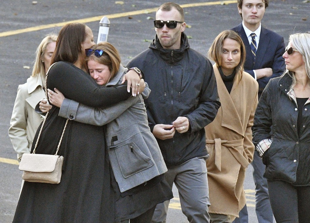 """Mourners leave St. Stanislaus Roman Catholic Church during calling hours for Schoharie limo crash victims; Abigail (King) Jackson, Adam """"Action"""" Jacks"""