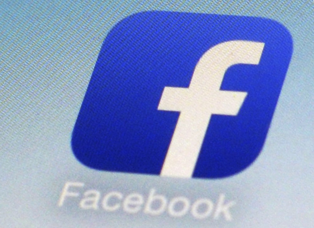 FILE - This Feb. 19, 2014, file photo, shows a Facebook app icon on a smartphone in New York. South Korea's telecoms regulator says it is fining Faceb