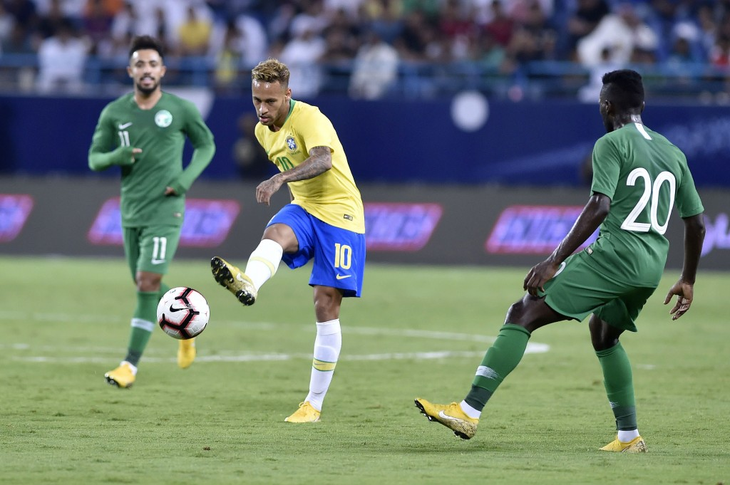 Brazil's Neymar, center, shots the ball during a friendly soccer match between Brazil and Saudi Arabia at King Saud university stadium in Riyadh, Saud
