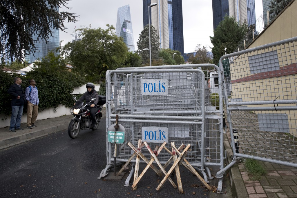 Bystanders look at the Saudi Arabia's consulate in Istanbul, Saturday, Oct. 13, 2018. Turkish officials have an audio recording of the alleged killing...