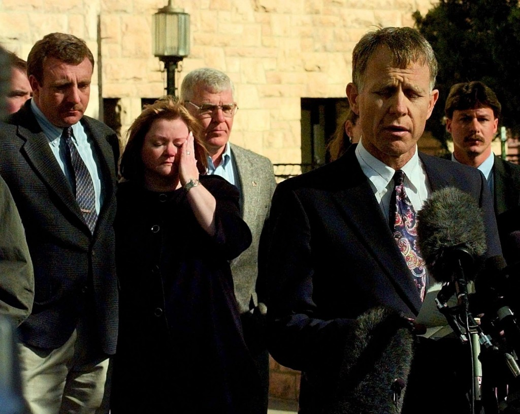 FILE - In this Nov. 4, 1999 file photo, Judy Shepard, left, wipes tears from her eyes with Detective Sgt. Rob DeBree at her side, as her husband Denni