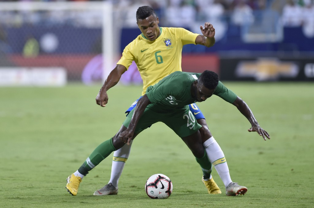 Saudi Arabia's Abdel Aziz Albishi competes for the ball with Brazil's Alex Sandro during a friendly soccer match between Brazil and Saudi Arabia at Ki