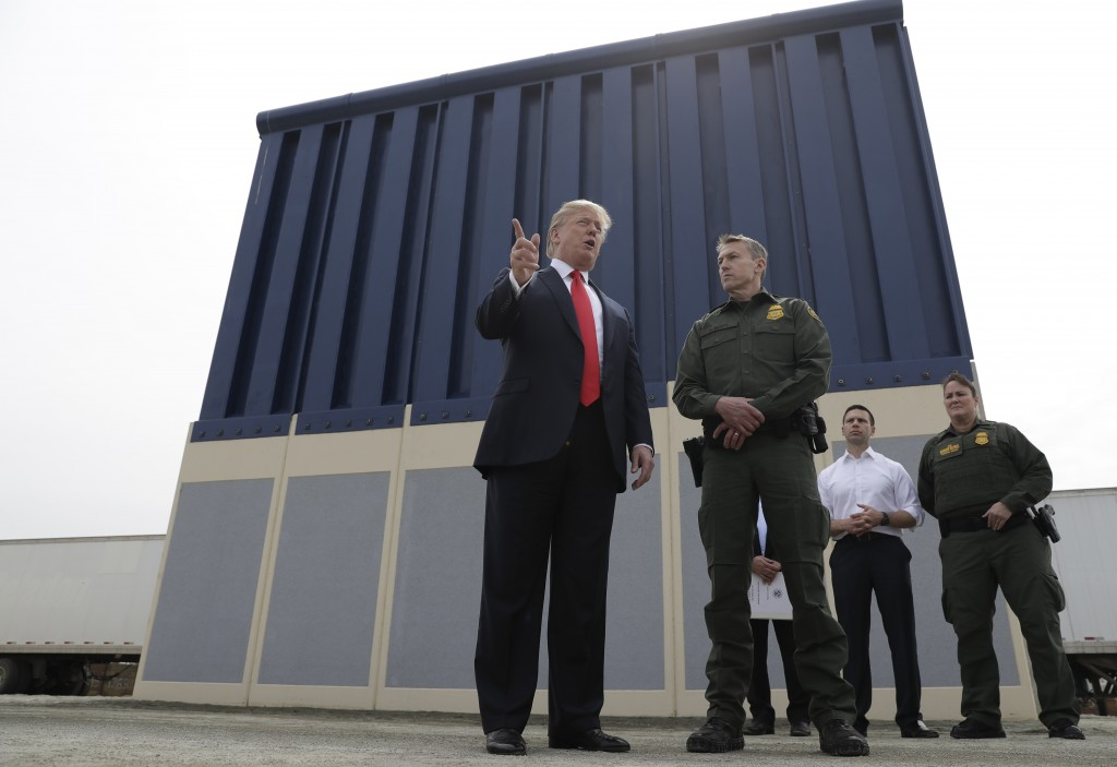 FILE - In this March 13, 2018, file photo, President Donald Trump speaks during as he reviews border wall prototypes, in San Diego, as Rodney Scott, t