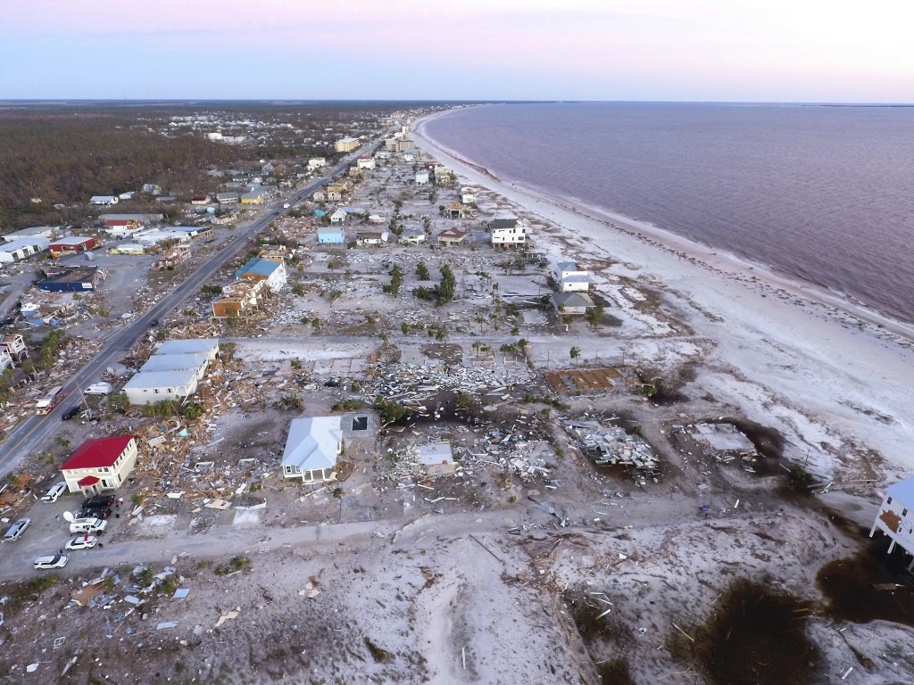 Damaged homes are seen along the water's edge in the aftermath of hurricane Michael in Mexico Beach, Fla., Friday, Oct. 12, 2018. (AP Photo/David Gold