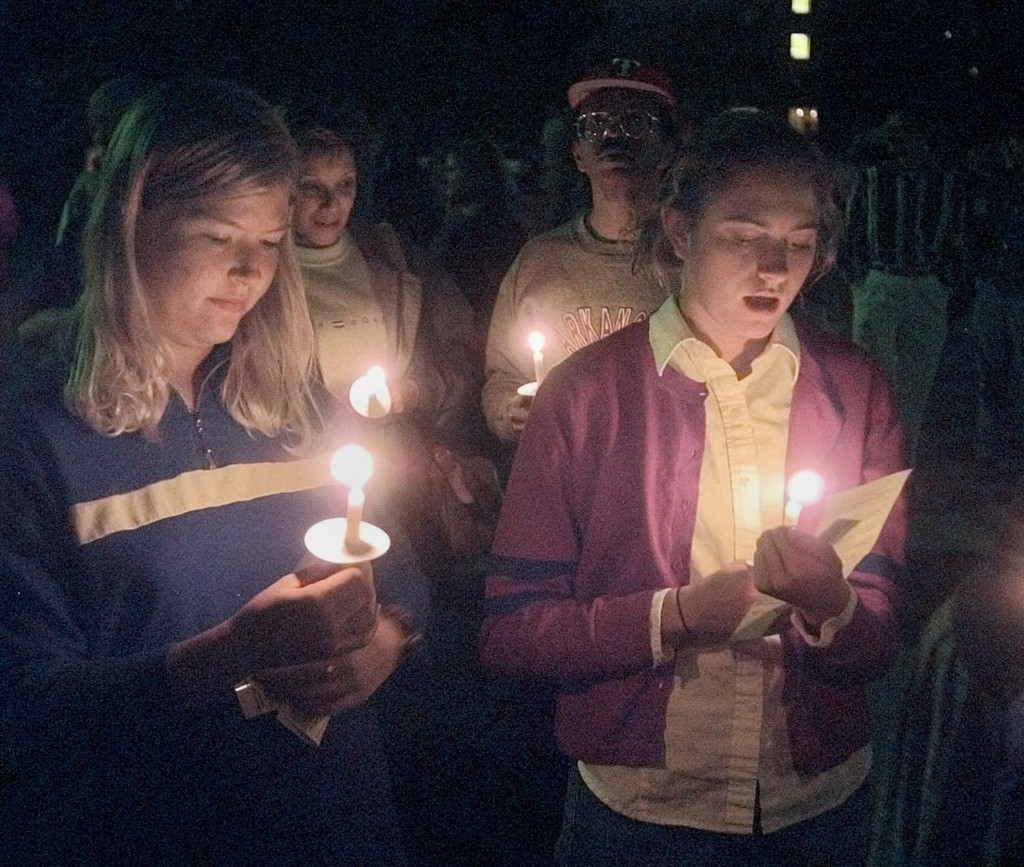 FILE - In this Oct. 10, 1999 file photo, students sing at a vigil against violence at Prexy's Pasture on the University of Wyoming campus in Laramie,