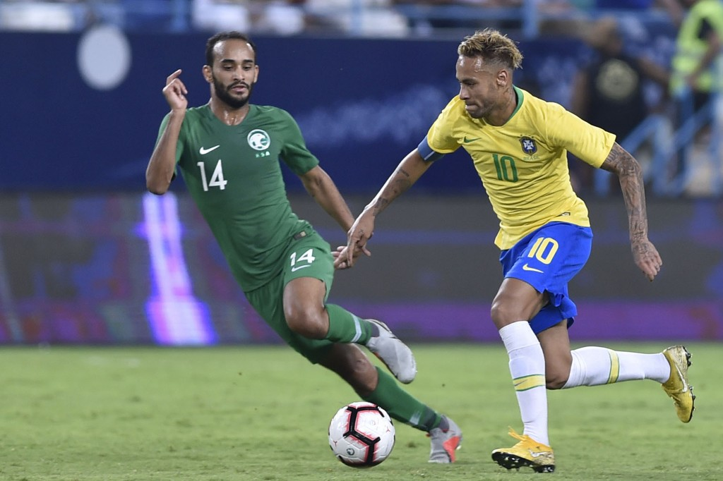 Brazil's Neymar, right, competes for the ball with Saudi Arabia's Abdullah Otayf during a friendly soccer match between Brazil and Saudi Arabia at Kin