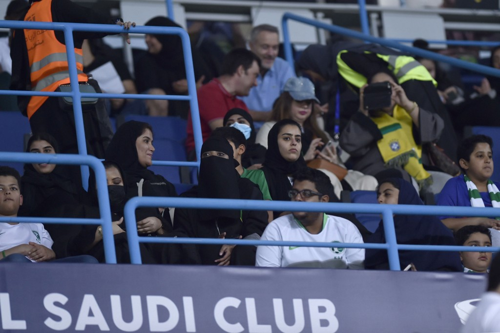 Saudi women watch a friendly soccer match between Brazil and Saudi Arabia at King Saud university stadium in Riyadh, Saudi Arabia, Friday, Oct. 12, 20