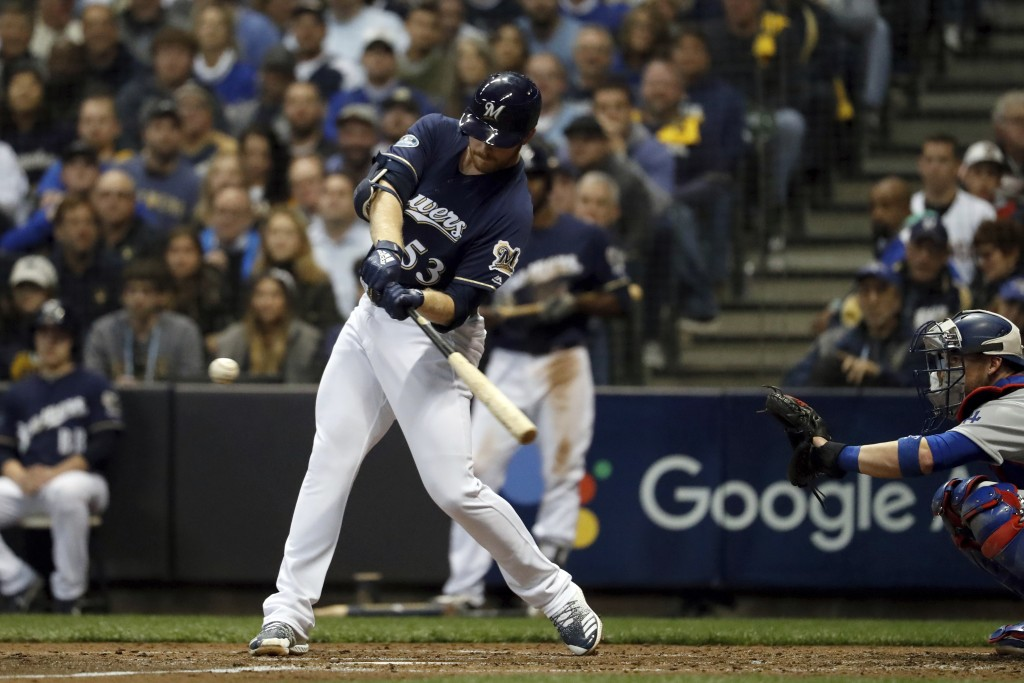 Milwaukee Brewers' Brandon Woodruff (53) hits a home run during the third inning of Game 1 of the National League Championship Series baseball game ag