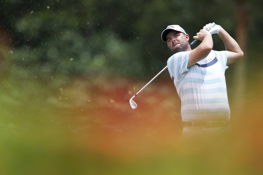 Marc Leishman of Australia follows his shot on the eighth hole during the third round of the CIMB Classic golf tournament at Tournament Players Club (