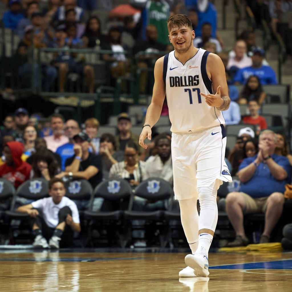 FILE - In this Saturday, Sept. 29, 2018, file photo, Dallas Mavericks guard Luka Doncic (77) celebrates after hitting a 3-pointer against the Beijing