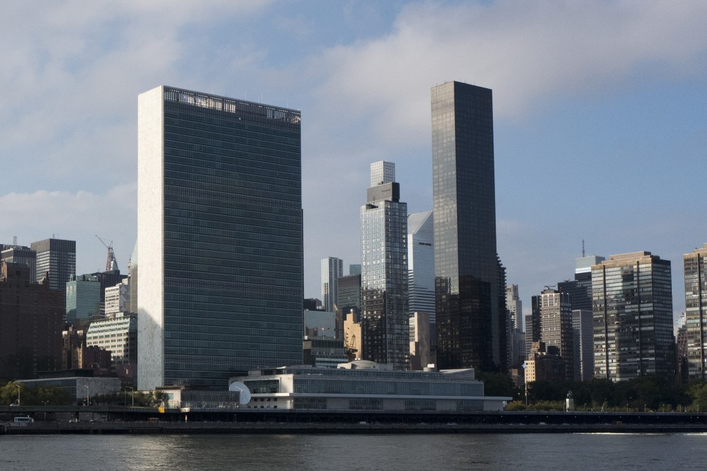 In this Oct. 10, 2018 photo, Trump World Tower, right, rises above the United Nations headquarters, left, in New York. In 2001, Donald Trump's busines