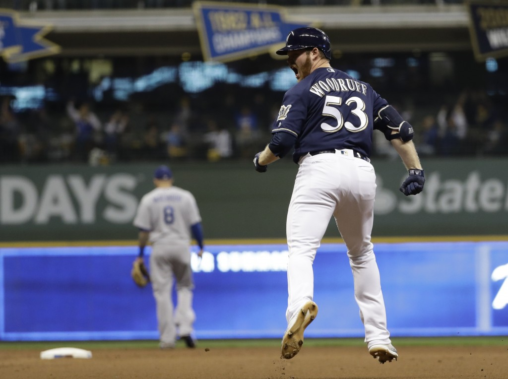 Milwaukee Brewers' Brandon Woodruff reacts after hitting a home run during the third inning of Game 1 of the National League Championship Series baseb