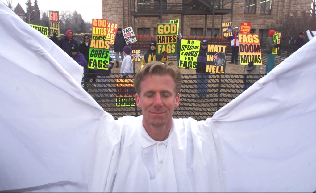 FILE - In this April 5, 1999 file photo, Ron Wilcoxson stands dressed as an angel as a response to anti-gay protesters from Westboro Baptist Church be